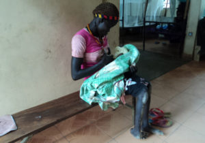 cripple-mum-attending-her-new-born-in-children-ward